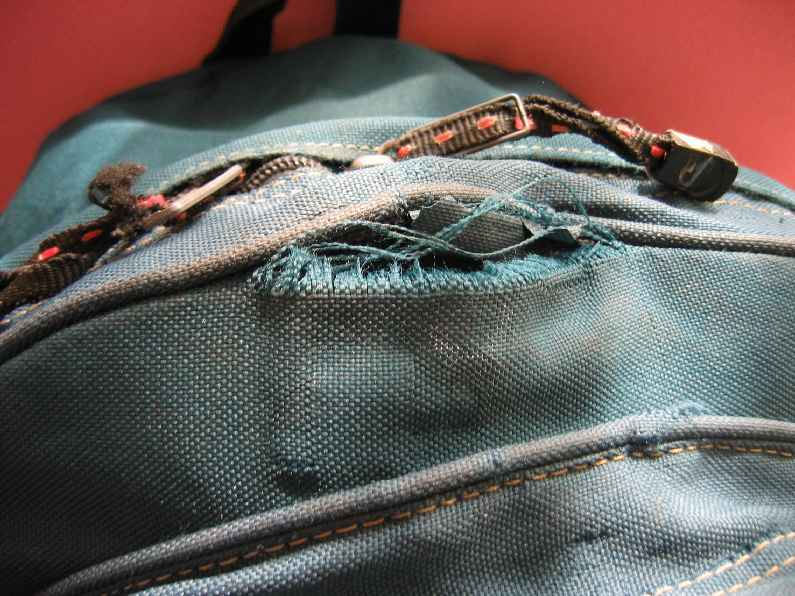 Torn Travel Bag